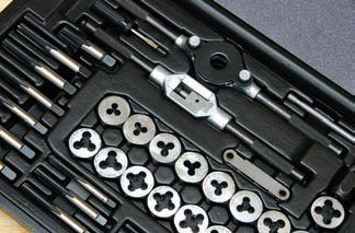 It's always good to keep a complete SAE/Metric tap and die set on hand for unexpected surprises. It's also a good idea to keep a set of bolt extractors on hand as well. When you have a bare core, chase all bolt-hole threads for accurate torque readings when it's time for assembly. Examine all bolt and hole threads as well.