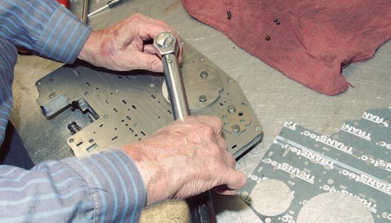 A torque wrench must be used on all phases of assembly, primarily in-lbs with automatic transmissions. Never use a torque wrench to loosen fasteners. If you're using a break-away torque wrench, always zero the adjustment after use. It is good to torque fasteners in one-third increments, then check all at least one additional time. Bolt threads should be lubricated with transmission fluid before tightening.