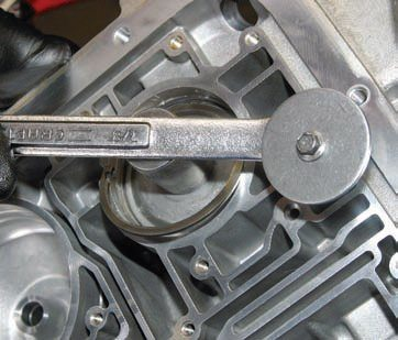 TRC uses a 7/8-inch wrench as a pry tool to remove servo pistons (shown). There's undoubtedly a specialized tool for this purpose, but why spend the money?