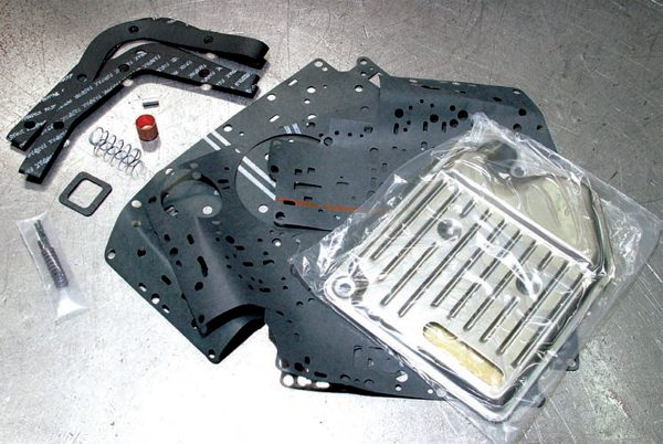 TCI's Trans-Scat shift improvement kit (PN 436000) is available in three forms: Street, Street/Strip, and Heavy Duty. For your street and weekend racing application, consider the Street/Strip kit. You want Heavy Duty for police, taxi, and towing, which delivers a firm, but not aggressive, shift.