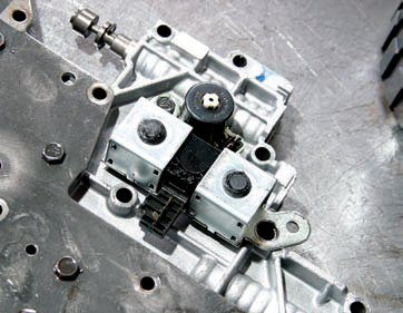 Both shift solenoids, SS1 and SS2, are on/off function and packaged together. Adjacent is the converter clutch solenoid, which receives a pulse input for smooth engagement.