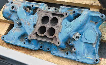 This is a C5AE-9425-M 289 4-barrel intake manifold casting. You see this casting more than any other in your search for a factory cast-iron 4-barrel manifold. If you're doing a restoration, you want a manifold with the appropriate Ford casting number. This manifold was designed for the square-flange Autolite 4100, Holley 1850/4150/4160, or Carter AFB/AVS. Any of the Demon carburetors fit. Make sure the throttle plates clear the spacer; you must use a spacer.