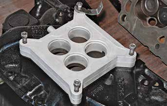 Factory carburetor spacers are approximately 1-inch wide. Spacers insulate the carburetor from engine heat. They also improve air velocity, which gives the small-block Ford better low- to mid-range torque. It is strongly suggested you use a factory carburetor spacer.