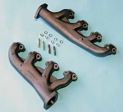 These are reproduction 289 High Performance exhaust manifolds, which were something of a cast-iron factory shorty header back in the day. First-year Hi-Po exhaust manifolds had a choke heat stove for the automatic choke, which went away when Ford changed to a manual choke with the 289 High Performance V-8.