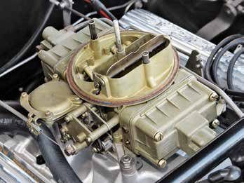 From this angle the Shelby/Holley 4150 LeMans-bowl carburetor reveals vacuum secondaries and a manual choke atop a Buddy Bar Cobra dual-plane high-rise cast-aluminum manifold. The 1966 Shelby GT350 equipped with a C4 Cruise-O-Matic was fitted with the Autolite 4100.