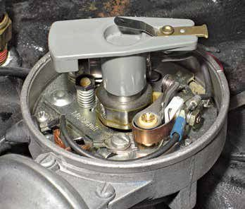 This is typical of most Autolite single-point distributors. Most have been rebuilt and are fitted with a replacement breaker plate like this one from Motorcraft. This replacement has a nylon pivot with a tinnerman's nut and nylon sliders.