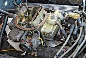 From this angle the 4180-C demonstrates its unique demeanor as a Ford-designed and Ford-calibrated Holley carburetor. It is set up for evaporative emissions with an electric choke and vacuum pull-off. There is also a fast-idle solenoid.