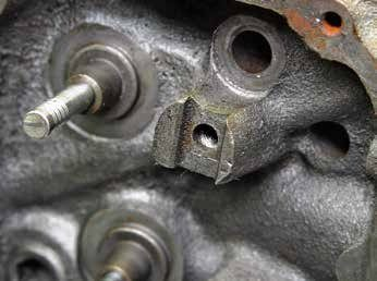 "When you're searching for 351C cylinder heads, watch out for the rocker arm pedestal type. It has a bolt-fulcrum pedestal designed for a bolt-fulcrum rocker arm, which is the ""set it and forget it"" no-adjust rocker arm. You can machine this pedestal for a screw-in stud-mounted adjustable rocker arm with pushrod guide plates."