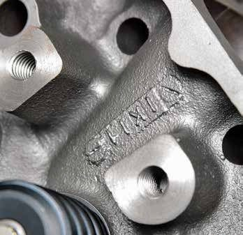 This Boss 351C cylinder head has a screw-in stud pedestal. The Boss and High Output heads were the only 351C cylinder heads cast for screw-in stud-mounted rocker arms and guide plates. The trick is distinguishing between the 1971 Boss and the 1972 High Output. The Boss D1AE casting has 61- to 64-cc chambers. The 1972 D2AE High Output head has the large 71- to 77-cc chamber. Although the 1972 head is rare, the 1971 head is more desirable.