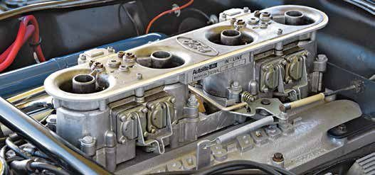 The Autolite In-Line 4-barrel racing carburetor, which was produced in two sizes, doesn't need an introduction for Ford Performance enthusiasts. It is an induction system most of us would like to have, yet it is very impractical for street use. There are several variations of the In-Line four and intake manifolds that support it. One of the manifolds is widely known as the Cross Boss. The large In-Line four, D0ZX-9510-B, had huge 21⁄4-inch throttle bores and flowed 1,425 cfm. The smaller version, D0ZX-9510-A, had 111⁄16-inch throttle bores flowing 850 cfm.