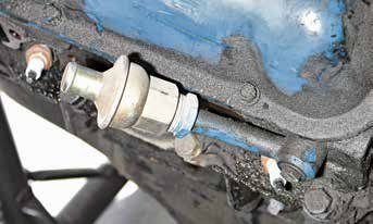 The air manifold check valve prevents exhaust pressure from backing up into the air pump. The check valve allows the flow of air one way into the exhaust ports, but not backward to the pump in case exhaust pressure becomes greater than air pump pressure under hard acceleration.