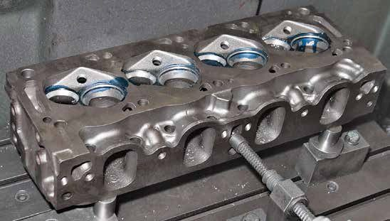 This Boss 302 cylinder head is receiving mill work at JGM Performance Engineering. Close inspection of the Boss 302 cylinder head proves that you can modify a 351C-4V head for use on a Boss 302 (and vice versa) because the basic casting is the same. All you have to do is close cooling passages with an epoxy resin filler and machine the head for either a Boss 302 or 351C-4V engine. You can also do the same with a 289/302/351W engine to create a Cleveland.