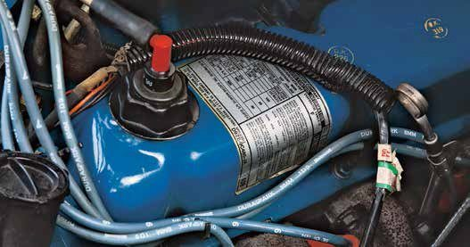 Ford used a pent-roof stamped steel small-block valve-cover in 1975. This valvecover continued into the early 1980s. Note the PCV valve and oil filler cap combination, which first arrived on the 351C engine in 1971.