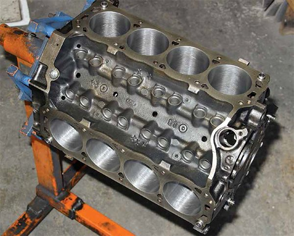 This is the Ford Racing E6ZM-6015-G351 race block, which is a dry-sump block engineered strictly for racing. This is a 9.200-inch deck height block with 2.750-inch mains borrowed from the 351C. There are variations of the E6ZM block with wet and dry sump.