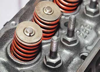 This 289 High Performance cylinder head has screw-in rocker arm studs, valves, retainers, keepers, and springs. Because these rocker arm studs screw into the water jacket, you must use a commercialgrade Teflon sealant to keep coolant where it belongs. (Permatex's The Right Stuff is also an excellent sealer for stud threads.) If you install them without sealant you will have coolant leaks.