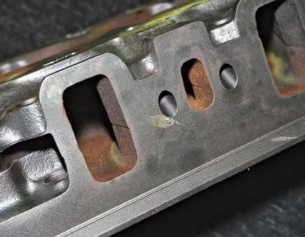 The 289 High Performance cylinder head has the same intake ports size as its 2V/4V counterparts, which means it doesn't breathe any more aggressively than the 2V/4V. An experienced cylinder head porting shop can perform wonders with a Hi-Po head without it being noticeable externally. Good port and bowl work reduces restriction and improves flow.