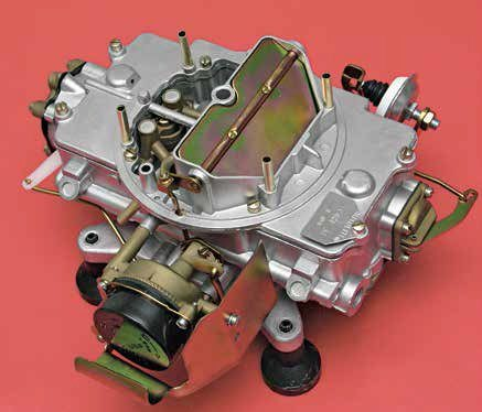 This is the 4100 from a different angle, revealing the heat-operated automatic choke system with fast-idle cam and adjustment. Intake manifold vacuum draws exhaust heat through a tube from the exhaust manifold, which acts on the thermostatic spring and choke plate. Ideally, you hand tune the automatic choke for minimal choke and get a good clean warm-up.