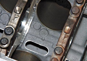Piston cooling jets have been phased out in production Coyote blocks, which probably means Ford believes there isn't a need for them. Piston oil-cooling jets were probably considered a necessity with hypereutectic pistons, but not with forged pistons.