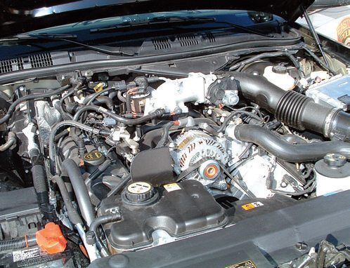 "This is the 4.6L SOHC Modular V-8 in a 2008 Ford Crown Victoria: a ""Mod"" or Modular engine mainstay since 1992. In 1992, the Modular V-8 was mechanically throttled. In 2008, it was electronically throttled, also known as ""drive-by-wire."" The days of goosing the throttle and revving the engine by hand are over."