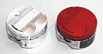The aftermarket offers a variety of forged and hypereutectic pistons for the Coyote. On the left is a Manley forged slug that yields 11.0:1 compression due to its domed crown. Valve reliefs are generous just in case you're considering more lift. On the right is a Manley piston with coated skirts. The high-temperature coating (red) protects the piston from temperature extremes and detonation.
