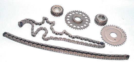The complete Modular timing system includes two primary chains (DOHC engines have two secondary chains for the quad-cam system), cam sprockets (only one is shown), two crank sprockets, and a reluctor wheel (for electronic triggering). Tensioners and chain guides are not shown here.