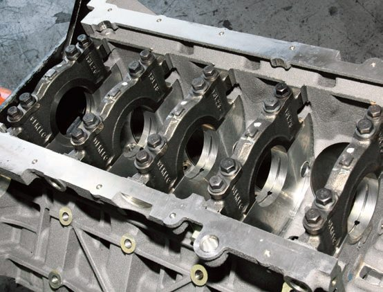 The Coyote's bottom end employs indestructible skirted, six-bolt main cap construction using larger bolts than on the 4.6L engine. These main caps are a perfect fit without jackscrews and wedges. They don't move even under extreme duty, enabling this engine to achieve a 7,000-rpm redline from the factory.