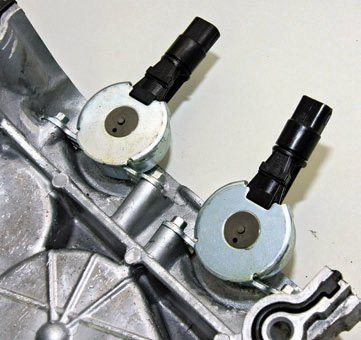 These oil pressure control valves cycle on and off to meter pressure to the cam timing actuators. They allow oil pressure to the actuators as necessary to alter valve timing.