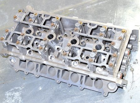 The 1993–1998 Twin-Port B-Series DOHC cylinder head had 52-cc four-valve combustion chambers. It was found on 4.6L Lincoln Mark VIIIs and Mustang Cobras through 1998. Easily recognized by its square and round intake port configuration, the Twin-Port head was a nice beginning, but better castings have since been developed. Although plentiful and cheap, this casting isn't the best choice for a DOHC build because of its limited-flow capacity.