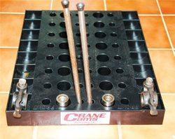 If you plan to reuse your original camshaft and lifters, keep these components and pushrods in the order in which they were installed in the engine. Cut holes in a piece of heavy cardboard, number the holes, and mark the components from each cylinder. This is an inexpensive way to keep your lifters and pushrods organized. (Crane Cams, Summit Racing, Jegs, or aftermarket performance camshaft manufacturers offer professional valvetrain organizers.) I also make a habit of keeping an old lifter box or two in my home shop as a simple means of keeping lifters organized as I remove them from an engine. Be sure to note the orientation of the lifters to the cylinders on the box, that is, front right, front left, etc.