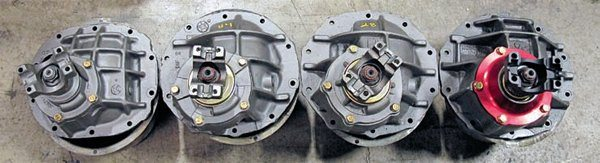 "The 8-inch center section casting (left) is made from regular iron with some strengthening ribs. It's hindered by the relatively small pinion bearing, as well as other areas where weight and cost were prioritized over strength. The standard OEM-style 9-inch casting (left middle) has a larger pinion bearing as well as deeper (though fewer) ribs. This style is good for up to about 450 hp. The Sportsman casting (right middle) has superior ribbing and is made of stronger nodular iron, as indicated by the ""N"" cast above the pinion bearing housing. It is significantly stronger due to the material used and other design features such as the larger Daytona inner pinion. This is good for about 650 hp. The Currie 9+ casting (right) has the larger, 3.25-inch carrier bearings (thus is able to use 35- to 40-spline axles) and nodular material. It incorporates the larger and stronger NASCAR pinion bearing. A steel pinion yoke is also evident, as is the billet aluminum pinion support that supports 850 hp."