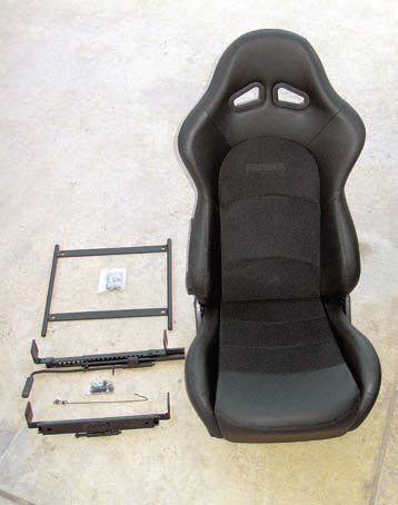 This is a Procar Sportsman Pro model. It is very much like a full-race seat in overall design, yet it reclines (for maximum comfort and support), can be tilted forward (to allow passengers to more easily get into the rear seats), and has a dual sliding mechanism to allow it to be properly positioned in terms of leg room.