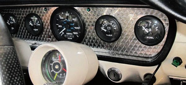 Many companies offer complete replacements for the factory instrument panel. This setup from Haneline Products replaces the factory gauges and even uses LEDs for the turn indicators and high-beam light. Variations include different combinations of gauges and/or gauge faces, changes to the number of gauges, insert finish (engine turned as shown here, camera case, woodgrain, etc.), plus completely custom setups where everything is open to your specification.