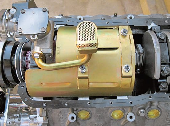 A properly designed windage tray does its job of keeping the oil and mist away from rotating parts. The main bolts (or studs) must be replaced with special ones made for the tray. Fortunately, Milodon uses high-quality fasteners similar to ARP's, which provide a similar level of strength and safety. The retaining nuts must be located high enough to keep the tray from contacting any moving parts (usually the rods) while remaining level. You might have to modify the tray due to the stud tips being closer together with the splayed four-bolt mains.