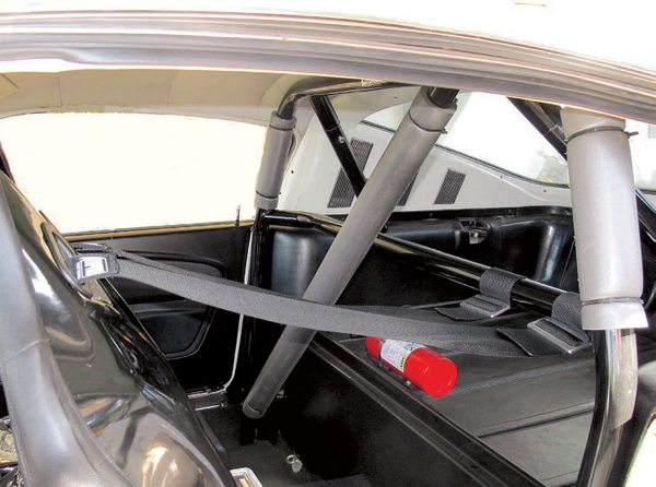 The installation of the race roll bar with a horizontal bar allows the use of proper shoulder harnesses for safety and to meet the requirements of many sanctioning bodies when racing. The Autopower harnesses are the simple wrap-around style, which offer the most flexibility. These Procar seats already had openings for them. They can also be used with most stock seats because they can be draped over the top of low-back seats, around the sides of some high-backed designs, and even around/under the headrests on seats that have them. Proper shoulder belts are critical for safety and driver stability.