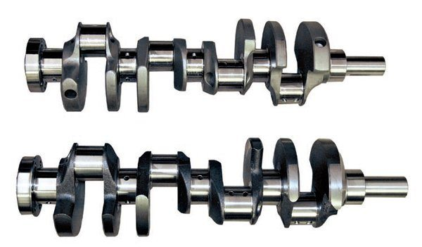 A stock cast crank (bottom) is fine for a daily driver or a moderately modified street car of 500 hp. Higher-performance street cars can still use a cast crank, but it needs to be an aftermarket cast-steel crank that's much stronger than a stock version. Metallurgy and manufacturing processes have greatly improved to produce a stronger crank. Most cast cranks have a tensile strength of 70,000 to 80,000 psi. They include many special features to further improve strength, durability, and reliability under higher loads. However, if you're building an engine of 600 hp or more you should use a forged-steel crankshaft. Forged cranks (top) handle the dynamic load and resist cracking and failure. The 4130 and 4340 forged-steel cranks have a tensile strength of 125,000 to 145,000 psi.