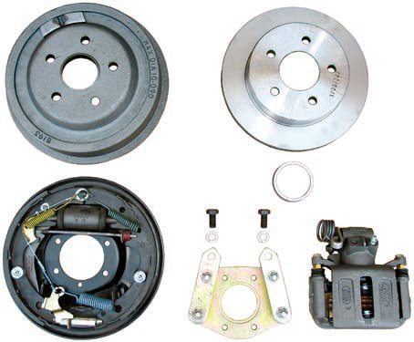 The differences between the OEM rear drum brake setup and a highquality aftermarket disc conversion kit by Currie Enterprises are obvious. The disc kit (top) is far less complex with fewer parts and less need for adjustments over time. The Currie kit (bottom) uses rebuilt and/or modified OEM components (in this case from a 1990s Thunderbird application) to provide superior braking while still being able to fit inside the stock 14- or 15-inch wheels. This is a far better option than the Granada setup because of its better performance and easy access to replacement pads.