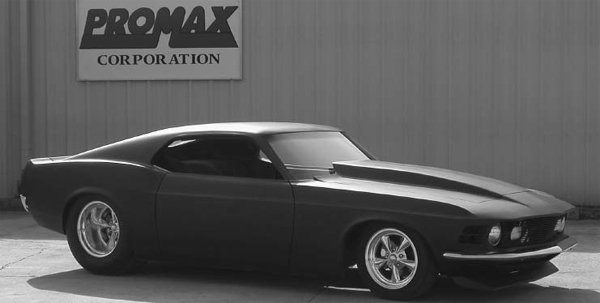 Promax Corporation is offering fiberglass-bodied versions of muscle cars. This is its version of the 1970 Mustang. Promax changed some of the body lines, modified the wheelbase, flush mounted the windows, and more. It's much lighter than the Mustang and it will never rust. (Photo Courtesy Promax Corporation)