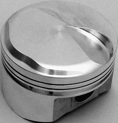 A domed piston decreases clearance volume at the top of the bore, which increases compression ratio.
