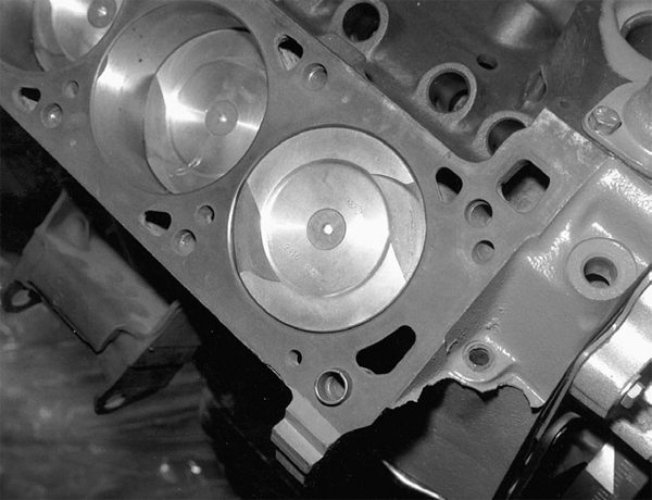 Here's a 351C with a dished piston to control compression. Note the oddduck valve reliefs for the canted-valve Cleveland heads. Ford called these poly-angle valves. These features figure in to clearance volume at the top of the bore.