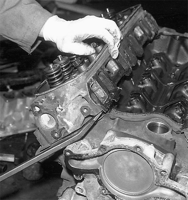Remove the cylinder heads next using a 1/2-inch drive breaker bar and the appropriate socket. Sometimes, cylinder heads need help with a pry bar or large screwdriver.