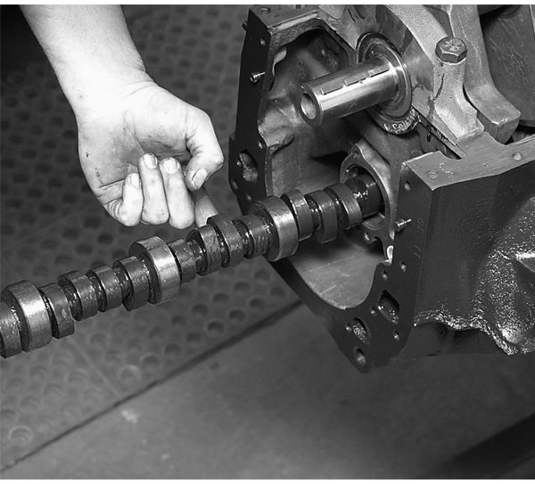 The Comp Cams High Energy hydraulic flat tappet camshaft is next. Note we have lubricated the journals and lobes for protection during start-up. Because this is a flat tappet camshaft, it will have to be broken in during the first engine firing. Break-in will consist of running the engine at 2,500 rpm for 20-30 minutes during the first start-up.