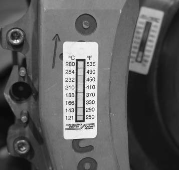 Performance Friction sells special stickers that show what temperature your rotor or caliper climbed to during use. If you look closely, you can see the sticker on the rotor has been up to higher temperatures than the caliper.