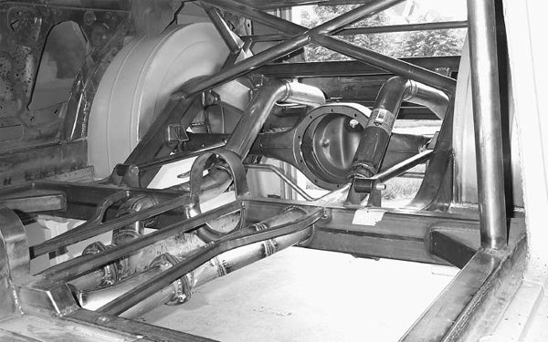 You can purchase mandrel bent frame rails and build a new frame for your entire car. This in-progress shot shows custom exhaust routing through the frame and the integral driveshaft loop. (Photo Courtesy John Parsons)