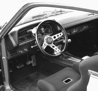 The interior is mostly stock, but it has been upgraded with Corbeau seats for comfort, style, and lateral support, all of which is necessary for the type of driving this car sees. The steering wheel is a Granada factory option – it fits perfectly
