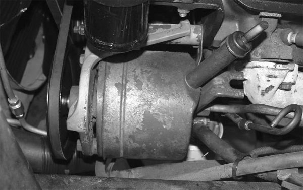 "This is a Thompson ""Slipper"" power steering pump. The name comes from the design of the internal slipper pistons. If you're planning on periodically running 20-minute sessions at your local road course, you might want to think about upgrading to a new-style pump."
