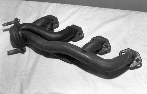Exhaust headers and mufflers create their own set of power losses. Factory shorty headers sure look like headers, but they're very restrictive. This costs you torque. The engine has to be able to breathe to make power. Aftermarket shorty and long-tube headers reduce restriction.