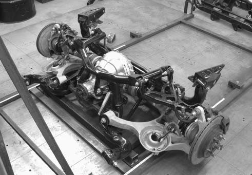The Cobra IRS is mounted to a bolt-in subframe. This set-up is waiting for engineers to fit it to the FR100 project. FR100 is a '53 Ford pickup, built by McLaren Technologies for Ford Racing Technology group. (Photo courtesy Ford Racing Performance Parts)