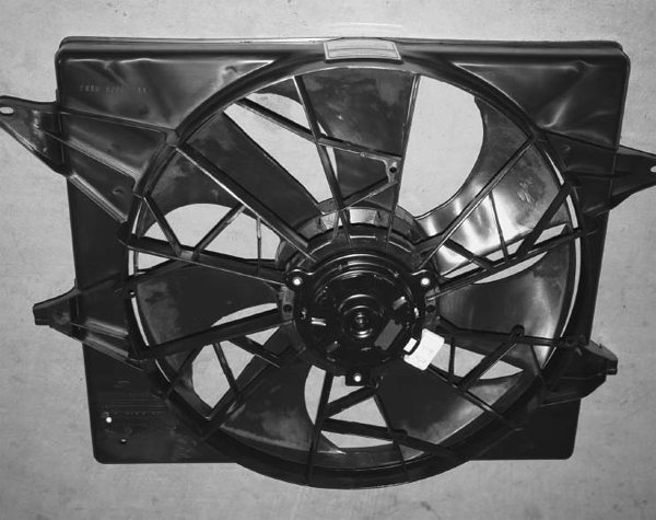 1. This Mark VIII cooling fan installation is in this chapter because of the electrical requirements to power this beast. Its continuous draw is 33 amps, but it uses close to 100 amps at start-up, unless it's controlled by a variable output controller. With the high amp draw, this fan needs at least a 130 amp alternator. The overall dimensions (without the four mounting tabs) are 22x18.5x6.25 inches deep (at the fan motor). Due to its size, most people remove the mounting tabs. This application had plenty of room, so they were left intact.