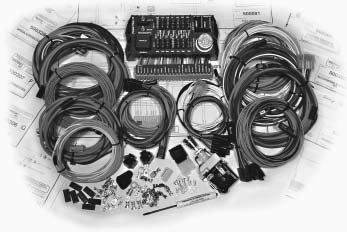 Electrical wiring harness kits like this Power Plus kit are somewhat universal. It comes complete with all the necessary plugs, connectors, wires, rubber boots, and a fuse box. (Photo courtesy American Auto Wire)