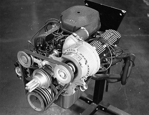 This is one example of a centrifugal blower on a Ford. The Paxton VR and SN superchargers, like the one shown here, force air through a carburetor (inside the shell on top of the manifold) to help an engine make greater amounts of power.
